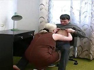 Mature mom loves young boy
