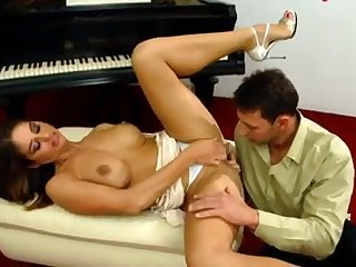 Fucking brunette on the piano