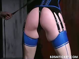 Redheaded is flogged on her ass