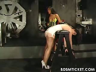 A babe is bent over and whipped