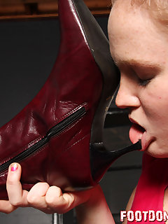 12 of Making her slave girl suck on her boot heels