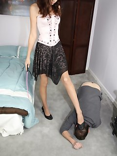 <!–-IMAGE_COUNT-–> of Crushing her shoes on slave's hands while he licks them